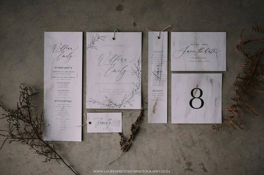 Wedding stationery with marble and concrete